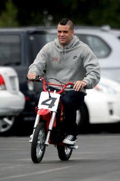 Mark Salling on a mini bike.