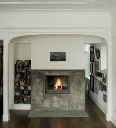 not sure how i feel about the elevated fireplace - but it does look so cozy //hearthhouse london
