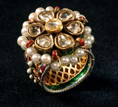 A ring, traditionally part of a 'hadphool', hand jewellery,decorated with multicoloured enamel, set with diamonds and the rim is decorated with pearls. - loved & pinned by www.omved.com