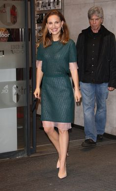 Natalie Portman in a green knit dress with nude Charlotte Olympia heels.