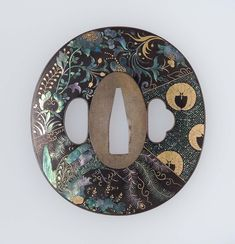 Tsuba with design of ho-o bird, wisteria mon and various geometric and floral patterns | Museum of Fine Arts, Boston