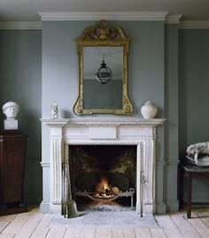 ~Jamb - The Chesham chimneypiece in distressed Portland stone with the Arts and Crafts fire basket and Stockton fire irons. A small Original Globe is reflected in the mirror. Vintage Fireplace, Fireplace Mantle, Living Room With Fireplace, Fireplace Surrounds, Fireplace Design, Antique Fireplace Mantels, Fireplace Ideas, Antique Mantel, Fireplace Lighting