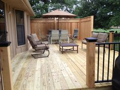 Pressure treated decking with cedar posts and privacy panels. Westbury aluminum railing.