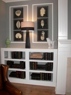 bookcase and art flanking fireplace