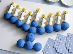 Menorah Cupcakes - Celebrate eight nights of light with these Menorah Cupcakes, made with vanilla cupcakes, chewy candies and blue sugar.