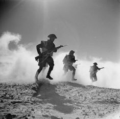 Posed photograph of infantry 'rushing towards enemy positions through a smoke screen' near Nufilia, 26 December Afrika Corps, Erwin Rommel, British Army, 303 British, Smoke Screen, Royal Engineers, War Image, Military History, Military Art