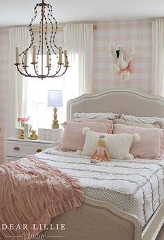 Adorable girl's blush pink room with gingham wall paper