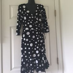 Maggy London Polka Dot Wrap Dress  Pretty girly dress perfect for the office. Very nice fit with ruffle flounce on the bottom. Tag is missing on dress (it itched lol). Only worn a few times and still in like-new condition. Make me an offer! ✨ Maggy London Dresses