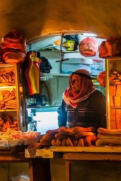 An Arab bread seller named  Salah at his stall in the souk, in the Muslim quarter of the old city, Jerusalem, Palestine.