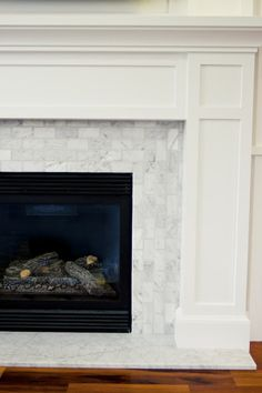 The Granite Gurus: Carrara Marble Hearth from MGS by Design