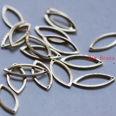 40pcs Raw Brass Charm Oval  16x7mm 3101C-M-324 by clbeads on Etsy