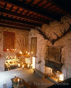 The 16th century banqueting hall at Chillingham Castle is a blaze of light