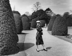 Striking a fierce pose, the brunette beauty pulls off a fashionable outfit whilst having a playful day at Kew Gardens