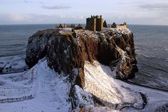 Dunnottar Castle, Scotland.  Looks like a mighty-fine place to crack a bottle of Macallan and enjoy a nice cuppa.