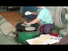 Making Fresh Spring Roll Wrappers - Video. She makes look so easy!