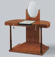 Émile-Jacques ruhlmann (french, 1879–1933). Colonette dressing table, 1919–20. amboyna burl veneer over oak, ivory and ebony marquetry panel, ivory, and silvered-bronze mirror; 47 1⁄2 x 43 1⁄4 x 23 5⁄8 in. (120.7 x 109.9 x 59.9 cm).