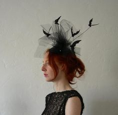 OMG__THIS SPEAKS TO ME!!  Leather bat and star speckled net Halloween Fascinator. $125.00.