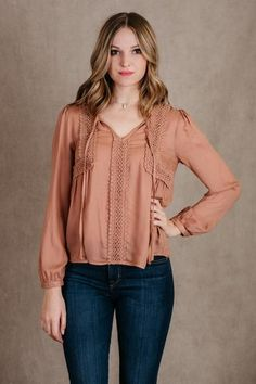 - Description - Details - Add little vintage boho flare to your outfit with our new Total Adoration Top! This peachy colored blouse features a bishop sleeve and embroidered detailing! Complete this lo