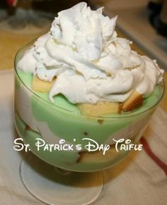 St. Patrick's Day Pistachio Trifle- a quick and easy dessert made with instant pudding, cool whip, Sara Lee Pound Cake and whipped cream on top!
