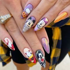 The stiletto nail shape makes Halloween nail art even spookier. Check out these 15+ designs. Disney Halloween Nails, Holloween Nails, Halloween Acrylic Nails, Halloween Nail Designs, Cute Acrylic Nails, Cute Nails, Halloween Art, Pastel Nails, Mickey Nails