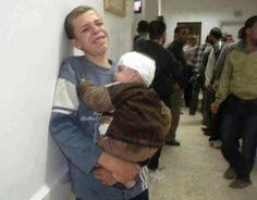 #Palestinian kid holding his brother, after their parents were killed in #Israeli attacks on #Gaza