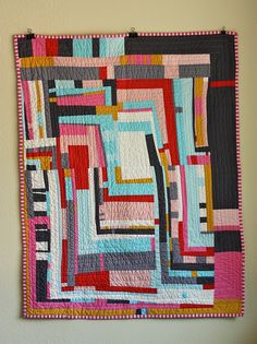 Wonderfully wonky quilt with strips of various widths and heights running vertically and horizonally - Gee's Bend influence