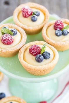 Vanilla Custard Cookie Cups! Bite-sized sugar cookie cups filled with a creamy vanilla custard and topped with fresh berries.   livforcake.com