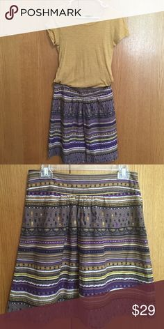 "Gold H&M top with color coordinating skirt Short sleeve gold H&M top with gold, purple, black and khaki colored patterned skirt. 20"" length, 15"" waist, size Medium, Susina brand. H&M Other"
