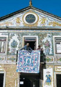 A Kaffe Fassett quilt in front of a Portuguese tiled facade