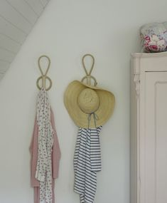 Display clothes and hats on wall hooks in the bedroom #IKEAFAMILYMAGAZINE