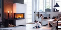 The Contura fireplace has an angled door and is clad in artstone. The door can be angled to the left or right to meet your needs. Add extra details such as a shelf and bench in black granite. A Shelf, Shelves, Grand Designs Magazine, Home Fireplace, Fireplaces, Granite Fireplace, Fireplace Inserts, Black Granite, Swedish Design