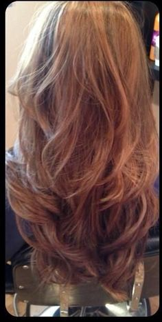 I want my hair cut in long layers like this. It keeps the length but lightens the weight.