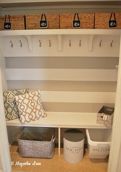 Our house doesn't have a mudroom, just a narrow hallway off the garage. To make it more functional, we removed the doors and added some built-in shelving. Now i…