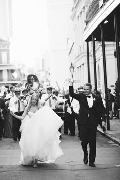 parading through the streets of New Orleans, this is so cute!!  Photography by The Nichols / jnicholsphoto.com