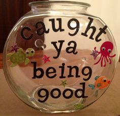 """Caught Ya""- Positive Reinforcement Jar- toss in a cotton ball or river stone every time you catch your child being good- when full give them a prize or reward"