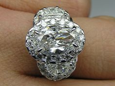 Oval Diamond Halo Engagement Ring Half Moon Side Stones