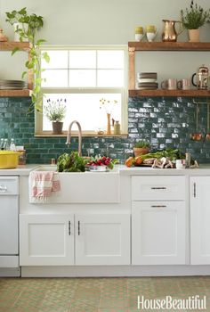 """This California Cottage Will Make You Fall in Love With """"Jungalow"""" Style Moroccan clay tiles from Badia Design cover the kitchen backsplash, and the wall is painted in Glidden's Silver Maple. Boho Kitchen, New Kitchen, Kitchen White, Kitchen Paint, Moroccan Kitchen Tiles, Eclectic Kitchen, Kitchen Small, Green Kitchen, Kitchen Floor"""