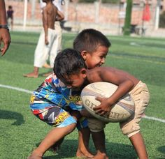 Cambodian children play with a rugby ball