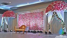 The floral wall with floral umbrella, works well! the design has 2 wings of floral wall on either side and its not been captured in this photo. always white makes it neat, and a perfect corner for your couple shots.