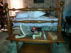 Dressing bench, luggage bench, incredible footboard Tues and maple bedroom set. Maple rocking chair seen in background.