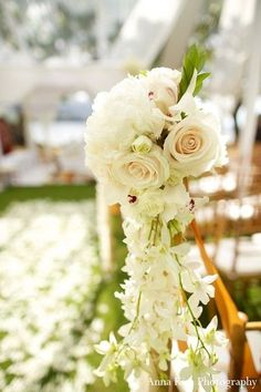White petals decorate an outdoor Indian ceremony in Hawaii.