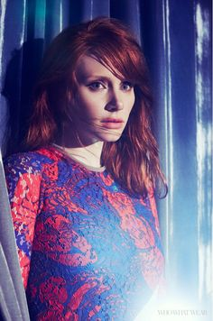 Bryce Dallas Howard wears minimal makeup with a red and blue lace dress by Carven