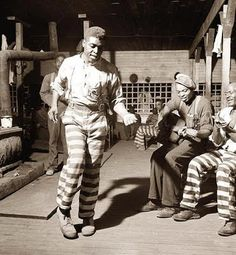 Greene Country Georgia in 1941.  men singing and dancing in the cell at the Greene County jail.