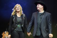 Hosts Trisha Yearwood and Garth Brooks perform onstage during the ACM Lifting Lives Gala at the Omni Hotel on April 2015 in Dallas, Texas. Get premium, high resolution news photos at Getty Images Country Singers, Country Music, The Band Perry, Happy Married Life, Entertainer Of The Year, Trisha Yearwood, Cma Awards, Garth Brooks, Famous Couples
