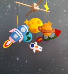 Space baby crib mobile with astronauts rockets and planets