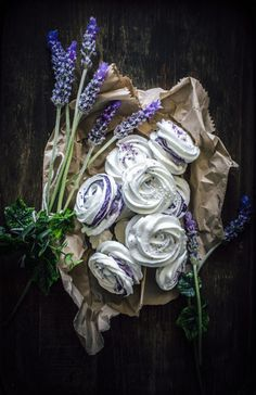 Meringue rose cookies with lavender cream cheese filling. (use blueberry juice instead of food colouring, for a natural violet colour)