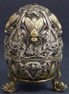 Found: Russian Silver Egg With Garnet And Stand. Reminds me of my grandma Barb because I called her Grandma B, she loved bees, and loved Russian eggs. Plus the grapes and garnet stones add to it for me Vintage Silver, Antique Silver, Antique Jewelry, Hives And Honey, Honey Bees, Felt Pincushions, I Love Bees, Sculpture Metal, Bee Skep