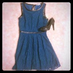Teal Lace and faux leather dress Teal lace and faux leather dress, perfect for the holidays! Zips on the side and has a key hole opening on back neck. Super cute on and very flattering! Speechless Dresses Midi
