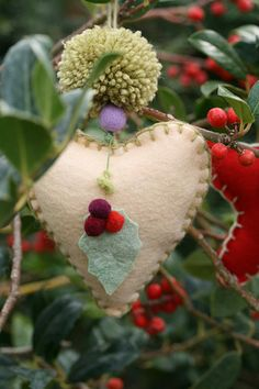 felt heart with pom and berries