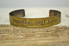practice self love handstamped on brass CUFF by MYPEACEofJEWELRY, $22.50